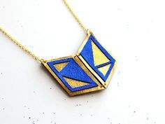 Handmade leather geometric necklace in gold and electric blue / N14. £14.00, via Etsy.