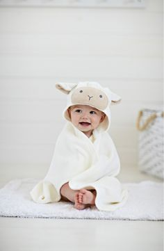 This snuggly wrap with a cute little hood keeps the baby cozy and warm after bath time.