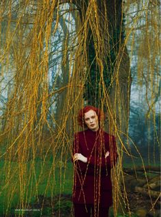 Leaning against a tree, Karen Elson poses in Celine wool jacket, sweater and pants for Harper's Bazaar UK Magazine July 2016 issue