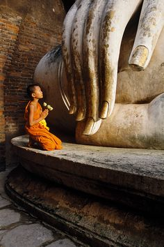 Prayer  -  Little monk in Ayutthaya, Thailand.