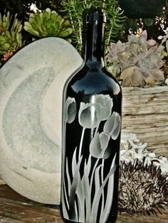 Tulips Design is carved / sandblasted onto empty wine bottles. The bottles are transformed into either oil lamps, or olive oil dispensers. This particular design features a 12 stage carving onto this thick glass bottle that weighs empty. Empty Wine Bottles, Gin Bottles, Bottles And Jars, Glass Bottles, My Glass, Glass Art, Engraved Glassware, Olive Oil Dispenser, Sandblasted Glass