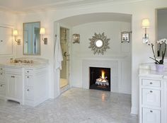 Nice bathroom....love the fireplace nook and that the double sinks are on opposite sides of the room!