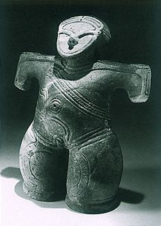 """Figure with a mask. Japanese ceramic figurine """"DOGU"""". Jomon period. BC.2,500 - BC.1,200. Excavation place / Ushiroda Yamanashi Japan."""
