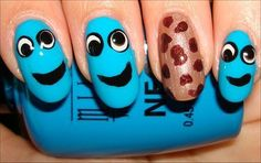 Cookie Monster Nails  Nail tutorial & more photos here: http://www.swatchandlearn.com/nail-art-tutorial-cookie-monster-nails/