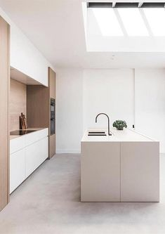 INSPIRATION: We're delivering more Belgian design for your Sunday with this custom kitchen by and Just as in this sleek and soft kitchen highlighted by the well-placed skylight overhead, everything to name is suffused with passion and craftsmanship. Custom Kitchen, House, Warm Colour Palette, Interior, Home, Interior Styling, Color Palette Design, Modern Kitchen Design, Kitchen Design