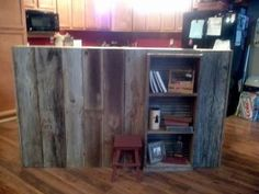 My brother built this.  The other side is a bar and stove.  That side is sheet metal, this side is barn wood with built in shelf.