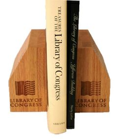"""Bamboo Bookends These handsome bamboo bookends are eco-friendly and have a transitional style that work with most decors. Each is laser-cut with """"Library of Congress"""" and the book logo. From the Library of Congress Shop."""