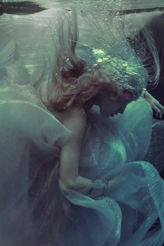 From dark beauty magazine--no underwater shoots for the dress samples but I love the colors.