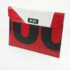 Fusebox - black, red and white macbook sleeve from M-24   Upcycled truck tarp bags made in the UK   Recycled truck tarp messengers