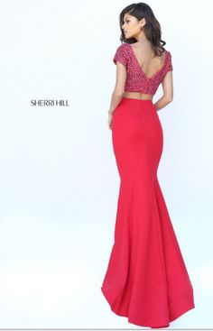 Sherri Hill has the most flattering and fashionable cocktail dresses to spice up your next party! Style 50614 available at WhatchamaCallit Boutique.