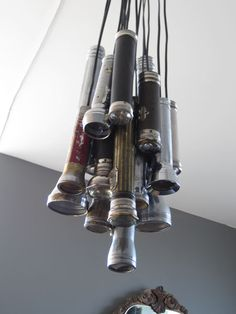 Light fixture created by Dolan from old flashlights. Each flashlight was purchased individually on eBay.