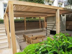 Formal Structural Garden | Timber arbour provides shaded seating area | Charlotte Rowe Garden Design