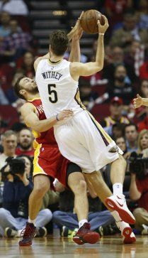 New Orleans Pelicans center Jeff Withey (5) runs into Houston Rockets forward Donatas Motiejunas (20) during the first half of an NBA basketball game at Toyota Center, Thursday, Dec. 18, 2014, in Houston. ( Karen Warren / Houston Chronicle  )