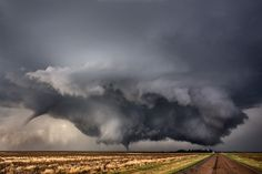 Twin tornadoes, May 24 near Dodge City, Kansas. This storm spent a surprising amount of its life sporting two or sometimes three tornadoes. Weather Cloud, Wild Weather, Weather Storm, Severe Weather, Extreme Weather, Cool Pictures, Cool Photos, Skier, Thunder And Lightning