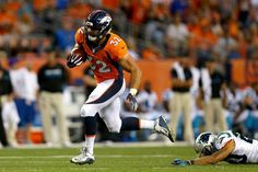 Fullback Andy Janovich #32 of the Denver Broncos scores on a 28-yard touchdown run against the Carolina Panthers in the second quarter at Sports Authority Field at Mile High on Sept. 8, 2016 in Denver.