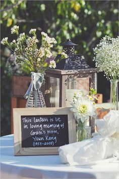 rustic in loving memory table / http://www.deerpearlflowers.com/country-rustic-wedding-ideas-and-themes/