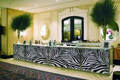 """Tall palms topped the zebra-print bar during the cocktail reception at Michael """"Pinball"""" Clemons Foundation's safari-theme gala in March 2010, which was held at the Four Seasons Hotel in Yorkville, Toronto."""