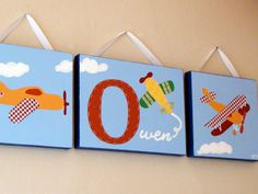 Set of 3 Airplane Paintings On Canvas With Child's Name and Hand-Stitched Fabric (Total Size is 12 x 40 inch). $150,00, via Etsy.