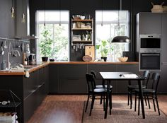 Astounding 10 Cool Dark Kitchen Design Ideas You Have To Know There is an emerging trend for dark kitchen designs now, though white kitchens remain popular because of their neutral background that suits everythin. Dining Room Furniture, Dining Chairs, Side Chairs, Small Condo Kitchen, Black Kitchens, Black Ikea Kitchen, Cuisines Design, Kitchen Interior, Kitchen Cabinets