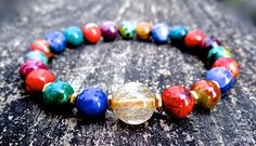 This gorgeous bracelet was made of genuine gold rutilated quartz, gold plated beads, sodalite, Indian agate, red jasper, mookaite, African turquoise and picasso jasper. You have all the 7 chakra stones/ crystals to balance your energy!