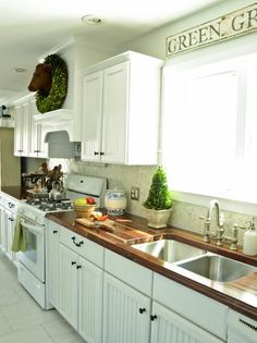White Country Kitchen With Butcher Block Countertops