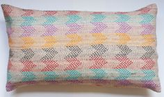 These pillows have been hand embroidered on Tassar silk by women artisans. This style of embroidery is known as kantha and is from the state of West Bengal in eastern India. Traditionally, a kantha is a light blanket made using old fabrics, softened from continuous wear that are sewn together with a simple running stitch or decorated with geometric patterns.