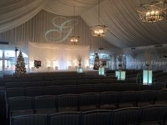 Above the backdrop, Elegant Event Lighting projected Alecia & Kenny's custom monogram to personalize the tent for the ceremony.