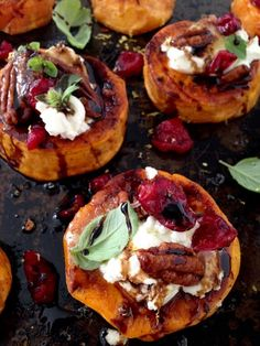 A Tray Of Sweet Potato Appetizers with Goat Cheese, Nuts, Honey & Balsamic Glaze