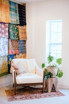 Wedding and Event Rental Company Showroom with a Mid-Century Wicker Safari Chair in Off-White Upholstery and Kantha Quilt Textile Wall via Birch & Brass Vintage Rentals in Austin, Texas