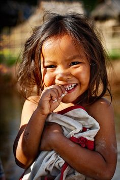"""As the Sun rises on a new day, the only umbrella you'll need is a smile."" (Laos)"