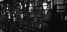 The Ipcress File (1965).  There is a walking chase scene (since one doesn't run in the library!)