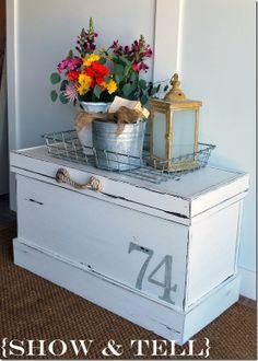 Hope chest, trunk, cedar chest, coffee table, storage, white, wire basket, galvanized pail, flowers, lantern