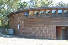 A round house in Pensacola, Florida, designed by flamboyant modernist architect John Lautner. Built in 1958, at the height of the Cold War, it includes a bomb shelter with a 30-inch-thick reinforced concrete ceiling, a hand pump well, a charcoal-filtered air system, and an escape tunnel.