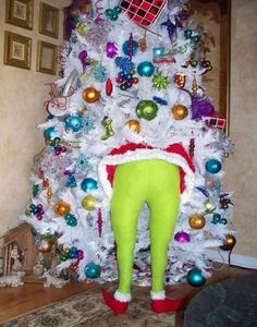 Stuff green tights with pillow stuffing and put in tree