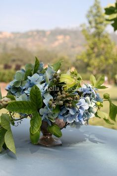 blue hydrangea centerpiece with green berries | lush flowers | floral design by Ariella Chezar