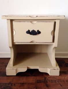 This $5 Solid wood nightstand I painted in a light tan- Sanded edges to show the Gorgeous Grooves!