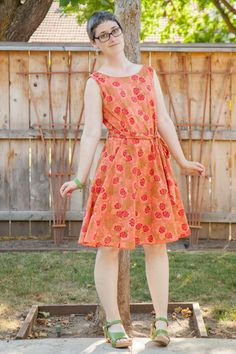 Salmon floral cotton dress, green Dansko sandals.