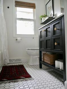 Our Fifties Fixer Upper: Hallway Bathroom black vanity vintage modern white mosaic tile black grout white and black bathroom