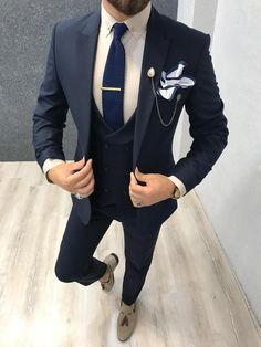 Collection: Spring – Summer 2019 Product: Slim-Fit Wool Suit Color Code: Navy Blue Size: Suit Material: wool, polyester Machine Washable: No Fitting: Slim-fit Package Include: Jacket, Vest, Pants Only Gifts: Shirt, Chain and Neck Tie Smart Casual Attire, Smart Casual Men, Mens Fashion Suits, Mens Suits, Groom Suits, Mens Wedding Suits Navy, Wedding Navy, Suits Women, Groom Attire