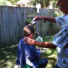 Hunter getting his hair cut in Florida by Uncle Wayne.