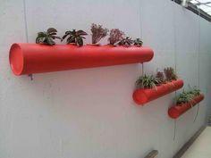 jardineras en tubos reciclados, idea del Arq. Eduardo Goubert