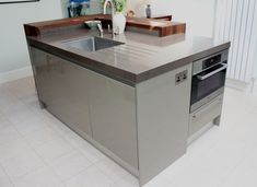 Microwave, integrated dishwasher and bin system and sink all within the kitchen island.
