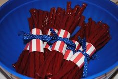 Cute for the 4th of July! All you need are a couple of bags of Twizzlers, some cute paper, and a spool of festive ribbon.