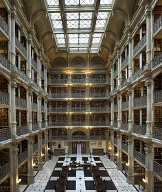 The George Peabody Library -1878. It was designed by Baltimore architect Edmund G. Lind, in collaboration with the first provost, Dr. Nathaniel H. Morison. Renowned for its striking architectural interior, the Peabody Stack Room contains five tiers of ornamental cast-iron balconies, which rise dramatically to the skylight 61 feet above the floor.
