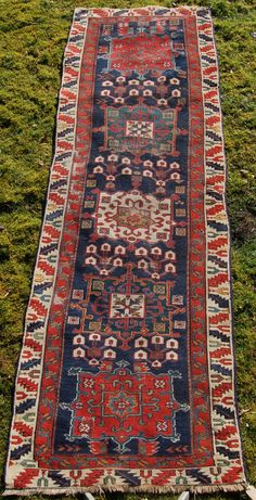 Antique Karaj long rug. 274 x 91cm. Good colour and bold design. Circa 1875. Outer border missing and some wear.