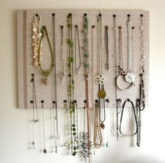 burlap-covered cork board necklace holder.  Looking for ways to store and EASILY find just the right neclace!