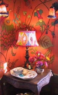 Bright wall treatment and lamp will work nicely inside the gypsie's caravan