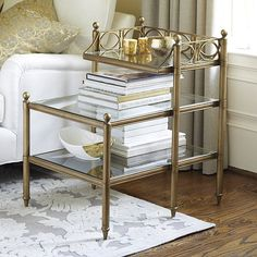 Tiered side tables are hard to find, especially with grand style like our Grand Marquis. Three stepped glass shelves create lots of serving and display space while keeping the look light and elegant.