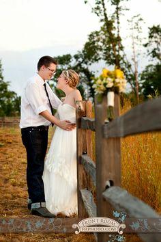 Wisconsin-Texas Wedding – Trista & Alton! » Milwaukee Wedding Photography – Front Room Photography Milwaukee Photographer - field - fence- bride and groom - country wedding - yellow flowers - Old World Wisconsin