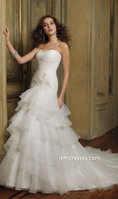 http://www.ikmdresses.com/Strapless-Organza-Wedding-Dress-with-Tiers-p87620